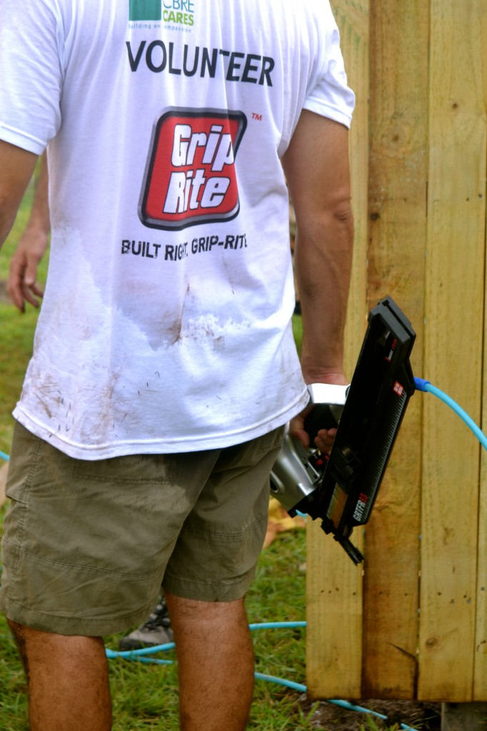 Installing the new fence with Grip-Rite tools.