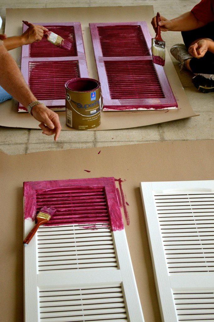 Painting the new shutters for the front.