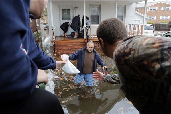 Photo Credit: NBC News - Residents of Moonachie helping each other as the waters rise from Hurricane Sandy.
