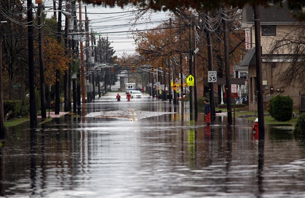 Photo Credit: NBC News - the water rises in Moonachie as the levee gives way.